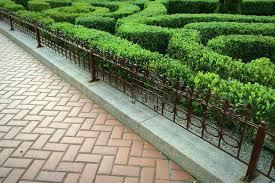 sett wrought iron fence and ornamental hedge stock image image
