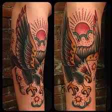 traditional eagle and sun on the arm traditional tattoos