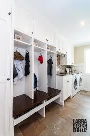laundry mudroom combo with custom cabinetry and wainscoting by