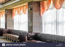 hotel lobby with large windows beautiful curtains and comfortable