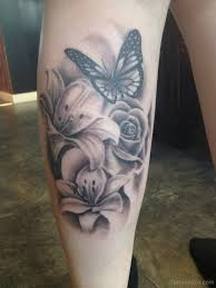 butterfly and flowers on back leg tats