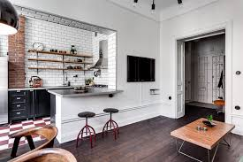living area opens on to the small kitchen featuring subway tiles living area opens on to the small kitchen featuring subway tiles and exposed brick in this apartment in stockholm