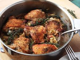 thanksgiving chicken dishes crispy braised chicken thighs with cabbage and bacon recipe