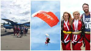 aussies dress up as santa claus and take on parachute jump