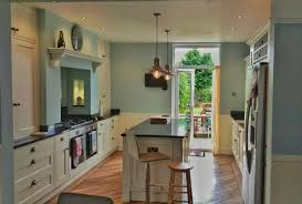 modern cottage kitchen very small breakfast nook set crystal chandelier above island