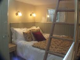Small Mezzanine Bedroom by Magical Artisan Cottage Beautifully Homeaway Wood Quay