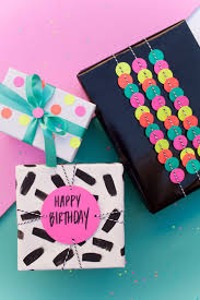 fun gift wrap ideas using a hole punch tell love and partytell