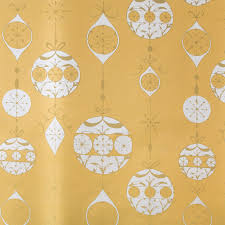 and gold christmas wrapping paper signature ornaments on gold roll wrap