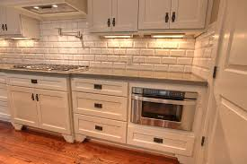 shaker style kitchen cabinet pulls white cabinets bronze drawer pulls and black countertops