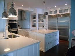 Kitchen Cabinet Appliance Garage by Kitchen Silver Refrigeration Ceiling Lights Dark Wood Floor