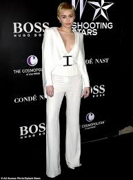 all white jumpsuits miley cyrus in plunging elvis inspired jumpsuit for w magazine