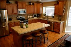 granite countertops giallo ornamental granite with oak cabinets