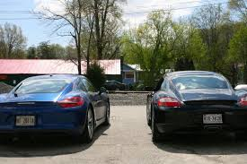 how much does a porsche cayman cost how much better is the porsche cayman than the one