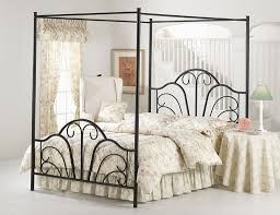 white floral bedding set and black four poster wrought iron bed