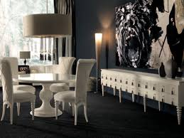 White Round Dining Table In A Dark Dining Room - Black and white contemporary dining table