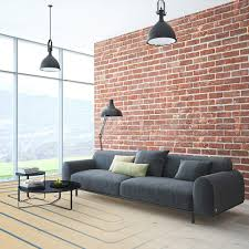canap chauffant salon avec un mur de brique et un grand canapé gris qui montre les