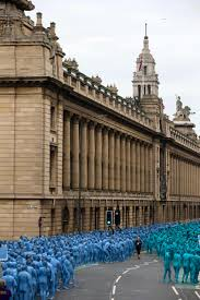 paint it blue thousands strip and paint themselves blue in uk for art