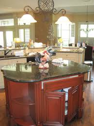 contemporary brown island kitchen layouts with black granite