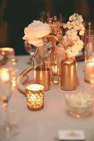 gold centerpieces mismatched gold dipped flower vases centerpieces