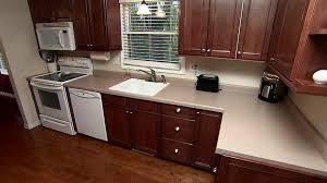 granite countertop white kitchen cabinets gray walls stove