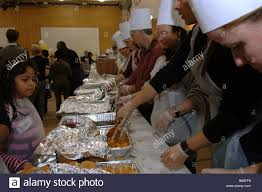 volunteers for the salvation army serve thanksgiving dinner to the