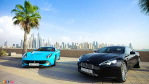 Ferrari F12 Blue - baby blue ferrari f12 berlinetta and black aston martin rapide