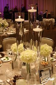 Vases With Floating Candles Tall Vases With Floating Candles Embellished With White Hydrangea