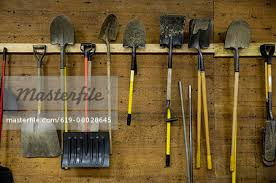 how to hang tools in shed shovels and tools hanging from hooks in shed stock photo