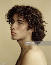 hispanic hair pics young hispanic man with curly hair looking away closeup stock