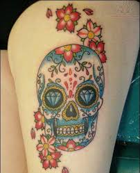 sugar skull and flowers thigh tattoos photos pictures and