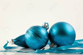 different blue ornaments on white background stock photo