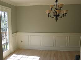 i like the white wainscoting with neutral color above the chair