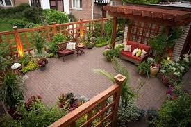 fence decor ideas patio traditional with red outdoor cushion wood