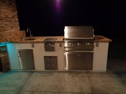 outdoor kitchen with table fire pit custom stools u0026 lc ovens 36