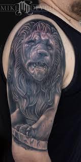 black and grey 3d lion statue tattoo on man half sleeve