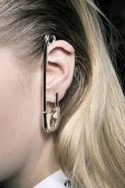 strange earrings who killed earrings