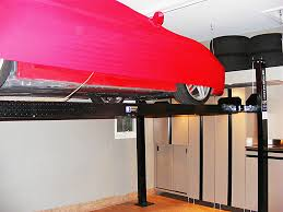 3 car garage aurora nuvo garage 3 car garage aurora auto lift slatwall organization system hooks shelves