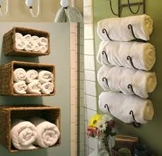 interesting white bathroom towel storage ideas with green wall