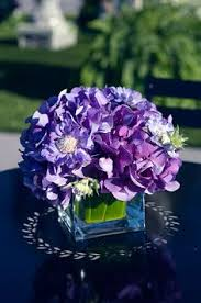 floating candle centerpieces blue u0026 purple hydrangea wedding