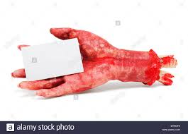 halloween blood background dead hand holding blank business card in a halloween horror stock