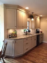 light color granite with dark cabinet pulls recessed lighting