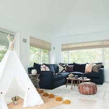 A Gold Play Tent Makes A Fun Place To Play In A Family Friendly - Kid friendly family room ideas