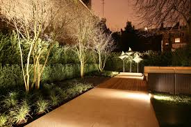 landscape lighting south florida downlighting on shrubs and flowers as opposed to uplighting on
