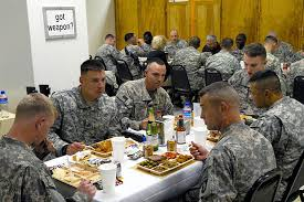 soldiers enjoy thanksgiving dinner with u s army col viet luong