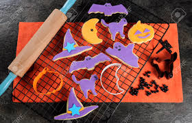 happy halloween orange and purple sugar cookies in cat hat