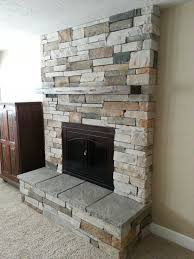 fireplace remodel cultured stone new insert raised hearth