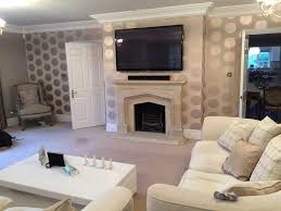 interior white sofa design with mounting tv above fireplace also
