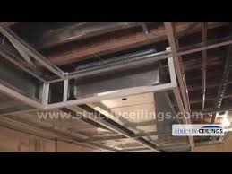 Suspended Drywall Ceiling by Installing Ceiling Drops For A Dropped Or Suspended Ceiling Youtube