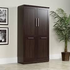 sauder homeplus basic storage cabinet dakota oak sauder homeplus storage cabinet in dakota oak walmart com