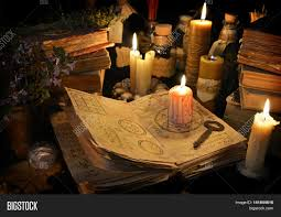 halloween text symbols halloween still life with burning candle on witch book and magic